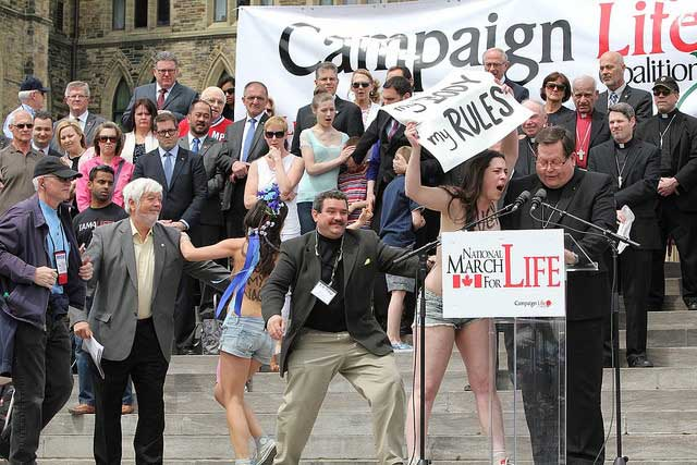 Topless protesters disrupt anti-abortion rally | Ontario